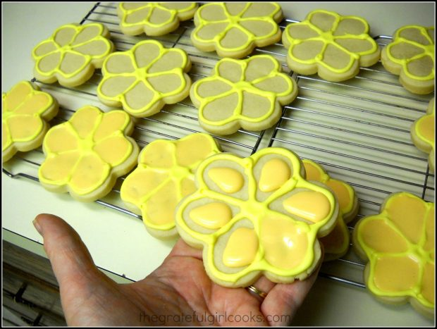 Light orange icing added to Spring Flower cookies