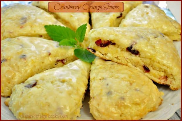 Cranberry Orange Scones, with a sweet citrus glaze, are a perfect breakfast treat or snack! They're delicious, and the easy recipe makes 8 scones!