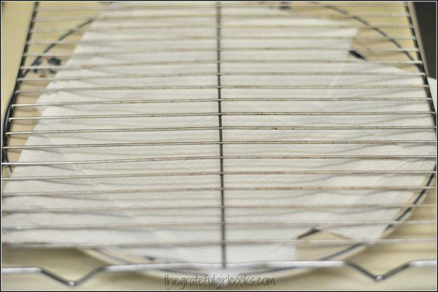 Wire rack to drain crunchy buttermilk fried chicken on
