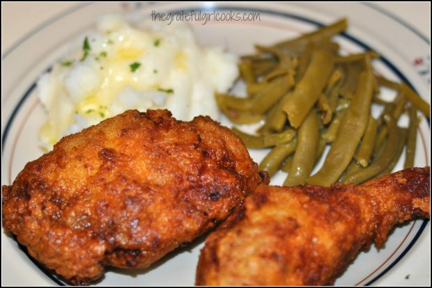 Buttermilk fried chicken on plate with vegetables
