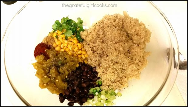 Cooked quinoa and other ingredients for casserole in mixing bowl.