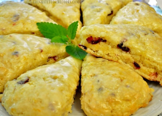 The finished cranberry orange scones, with a mint leaf garnish, ready to eat!