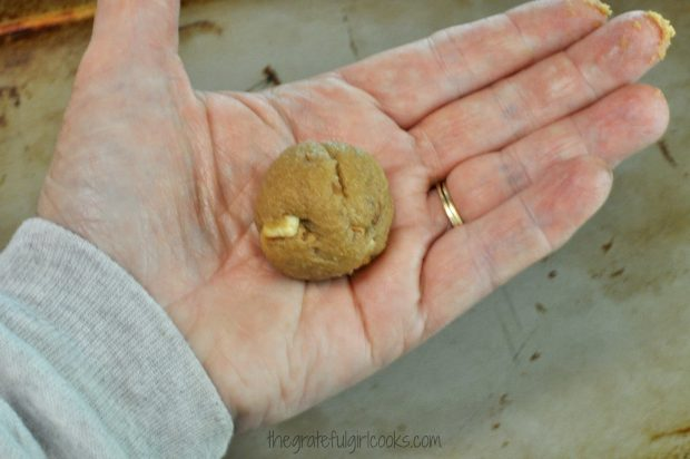 The cookie dough for butter pecan crisps is rolled into small balls before baking.