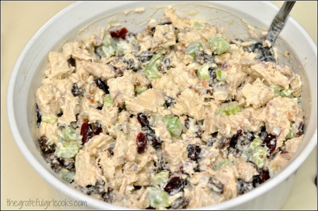 Ingredients are mixed with condiments and seasoning to make chicken salad.