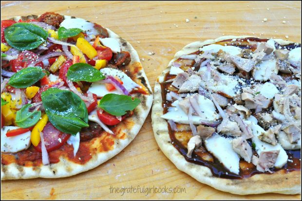 Pizza dough is removed from BBQ and toppings are added, then back onto BBQ grill