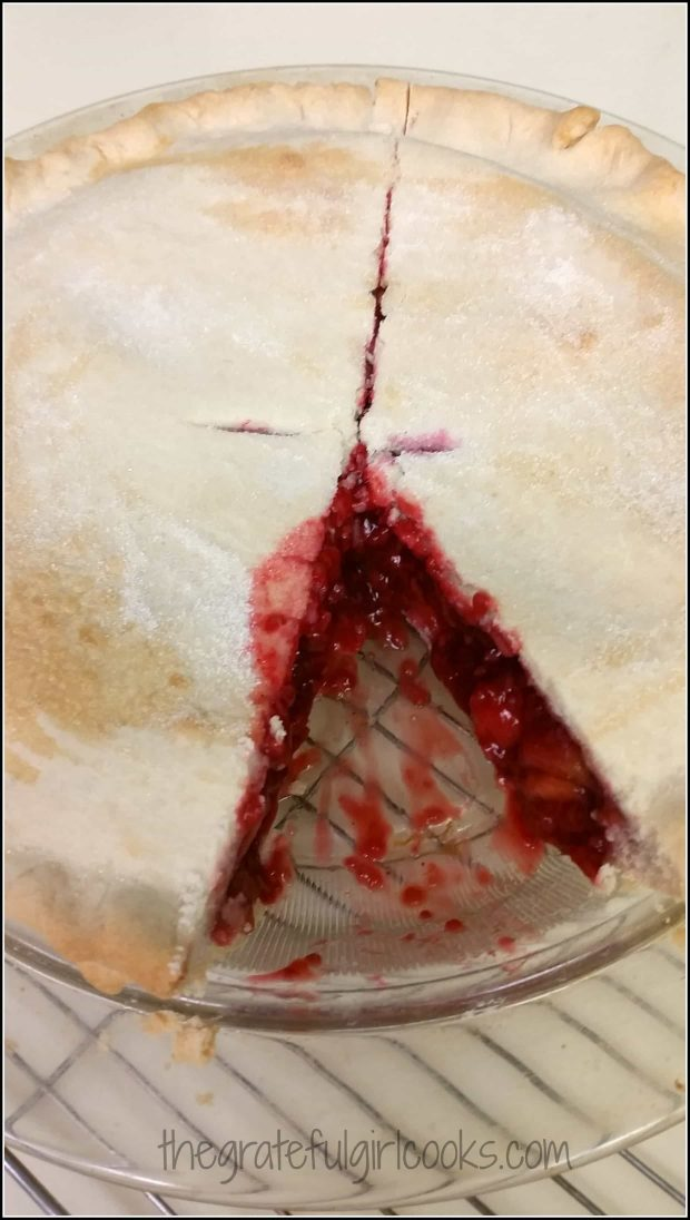 Slice of pie is removed to show raspberry-peach melba pie filling.