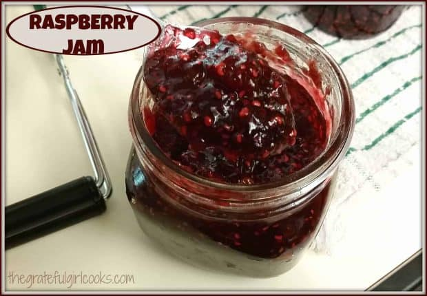 Making homemade raspberry jam and canning jars of it for long term storage is a great way to enjoy the taste of fresh summer raspberries all year round!