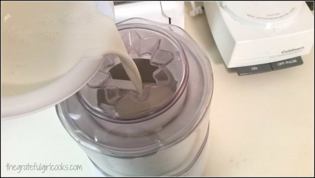 Ice cream base is poured into machine for freezing.