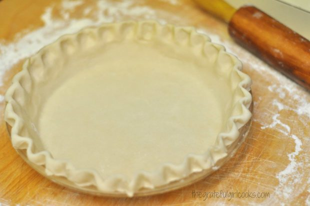 Empty pie crust and rolling pin used to make a strawberry pie.