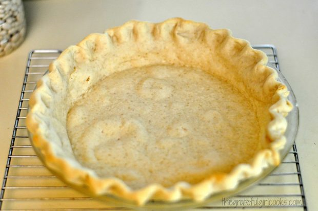 Baked pie crust cooling on wire rack