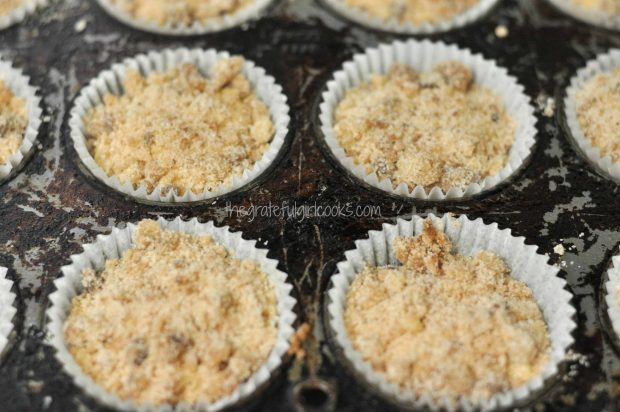 Batter with streusel on top in muffin tins