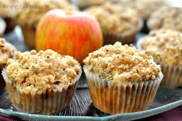 Two muffins close up with apple on plate
