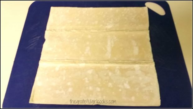 Puff pastry is rolled out and perforated lines in dough are sealed.