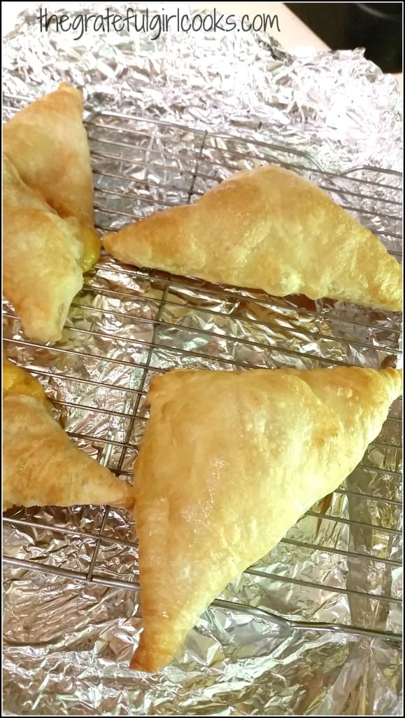 Peach Turnovers are baked, then cooled on wire rack.