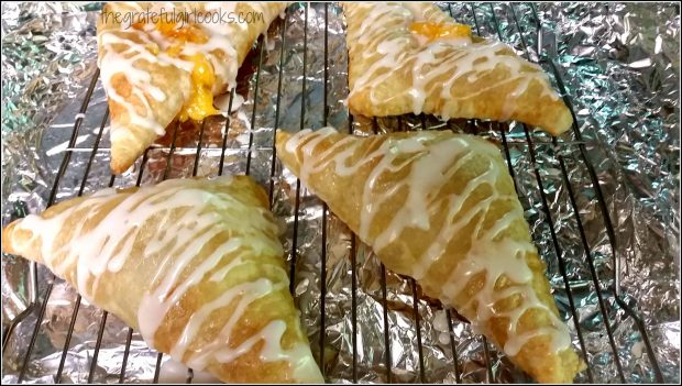 Peach Turnovers are drizzled with glaze once cooled.
