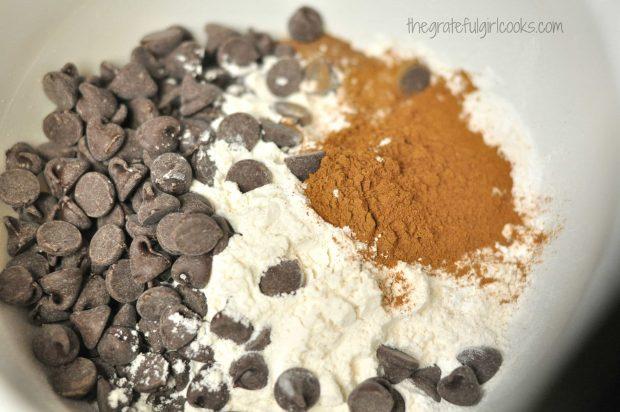 Adding ingredients to make pumpkin pancake batter.