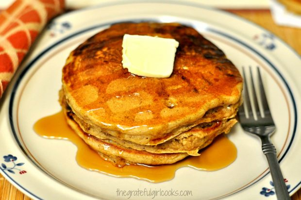 Pumpkin chocolate chip pancakes served with butter and maple syrup.