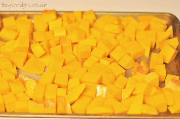 Roasted butternut squash requires squash cubes, tossed in olive oil.
