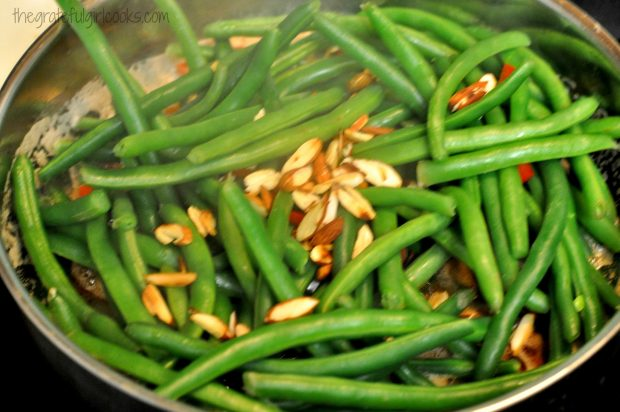 Toasted almonds are added to the skillet with the brown butter green beans.