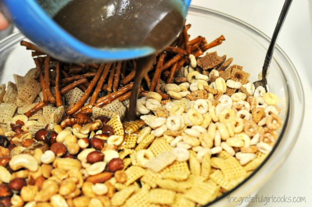 Sauce added to chex mix in bowl, then stirred to blend.