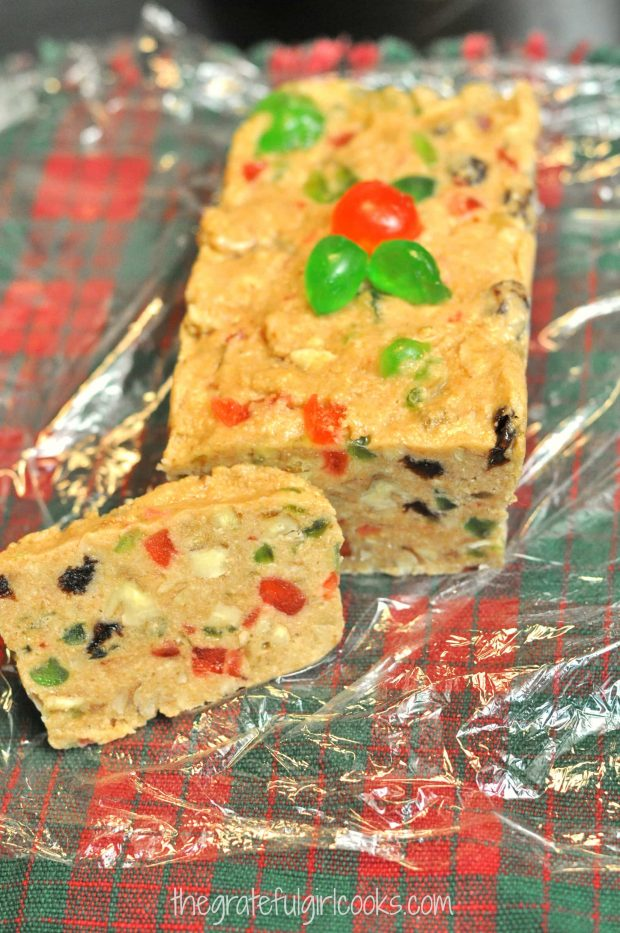 Mom's refrigerator fruitcake garnished with candied cherries, and sliced to serve.