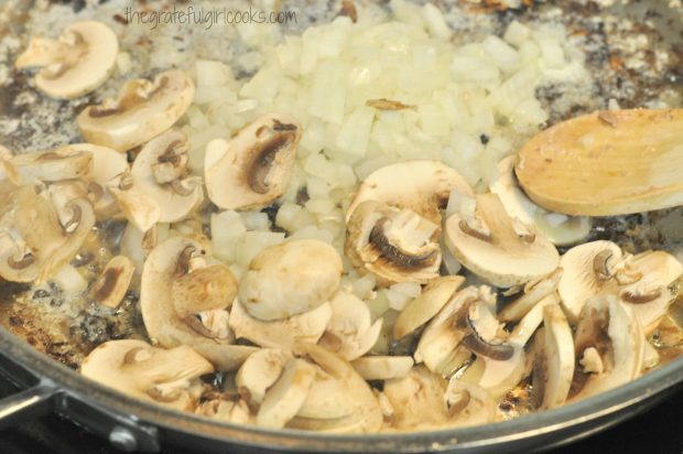 Mushrooms and onions cooking in skillet