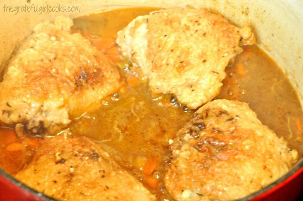 Chicken pieces for chicken thigh osso bucco, are added to sauce, to bake.