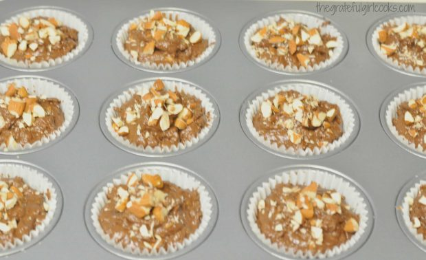 Chocolate almond chia muffins batter in muffin cups, are ready to bake!