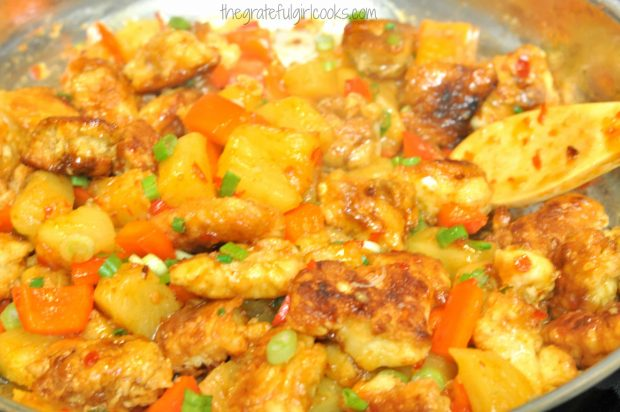Browned chicken is added to the sauce in skillet, to make sweet fire chicken.