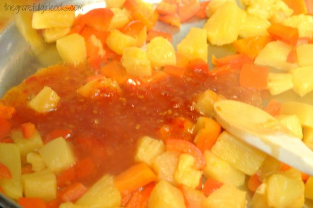 Red bell pepper, pineapple and sweet chili sauce are heated for the sweet fire chicken sauce.