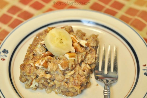 Piece of baked banana bread oatmeal on plate with a fork