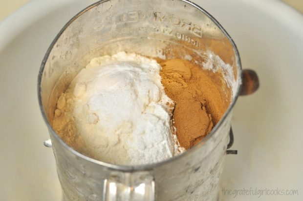 Flour, cinnamon and spices for Edie's carrot cake, cake in sifter.