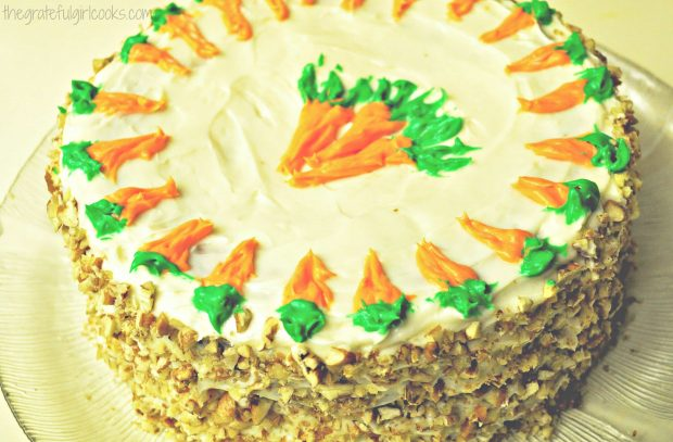 Edie's carrot cake, with frosting and toasted pecans decorating it.
