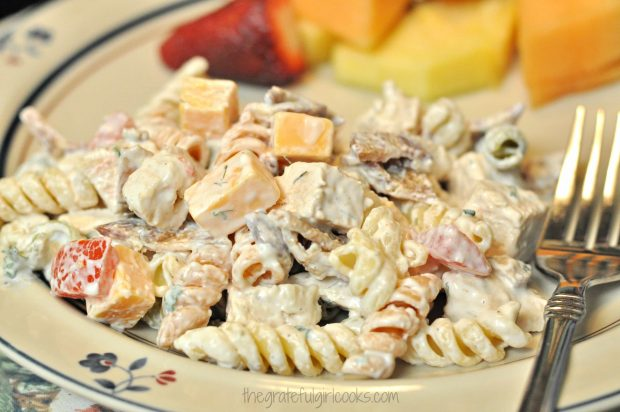 Chicken club pasta salad, on plate with fresh fruit