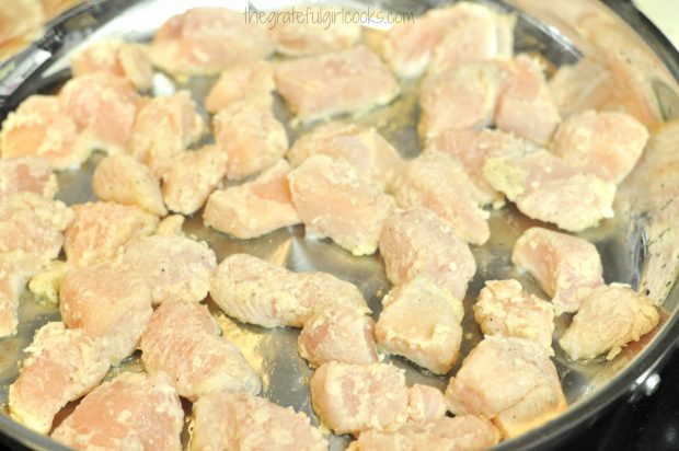 Chicken pieces are cooked in very hot oil until browned.