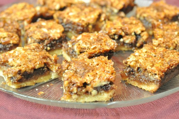 Chocolate Pecan Pie Bars on a platter, ready to eat!