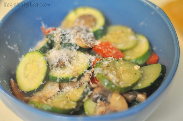 Finely grated Parmesan cheese is sprinkled over the skillet zucchini before serving.