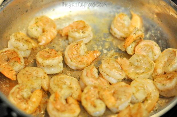 The seasoned shrimp are pan-seared in olive oil.