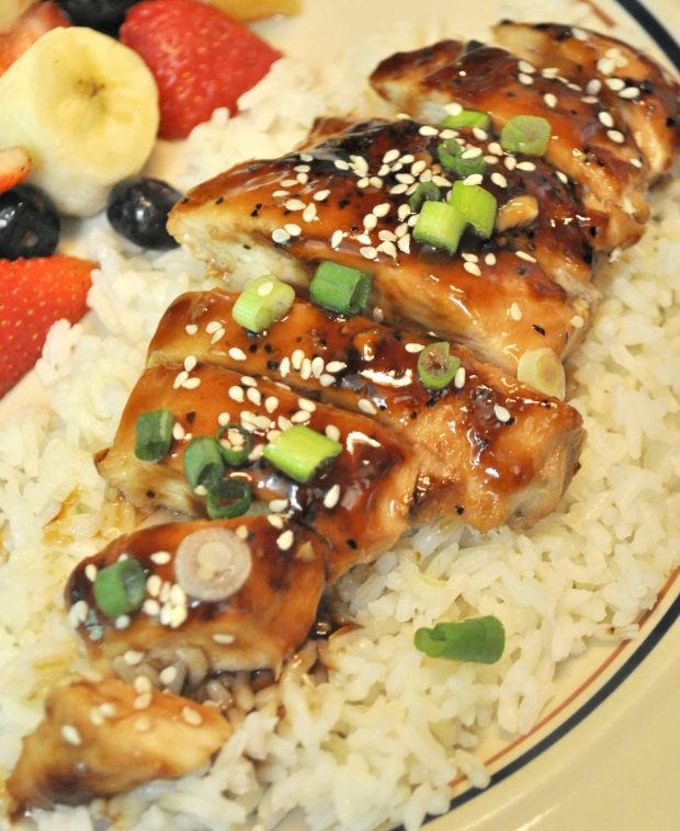 Teriyaki chicken with sliced green onions, on top of white rice