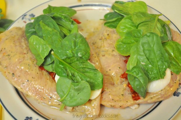 Baby spinach leaves are added to the stuffed chicken breasts.