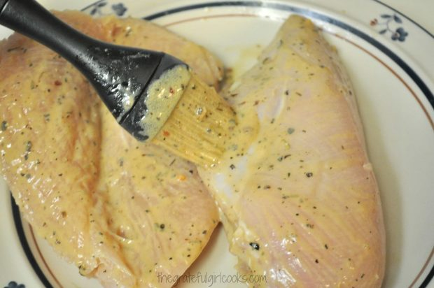 Sauce is brushed onto all sides of the chicken breasts.