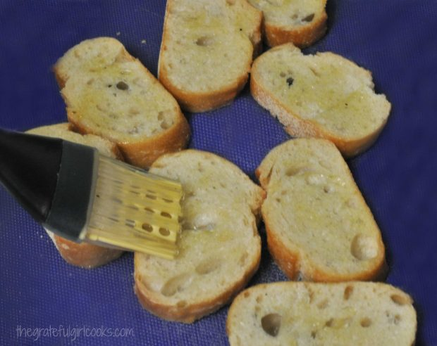 Olive oil is lightly brushed onto baguette slices for Classic Bruschetta.