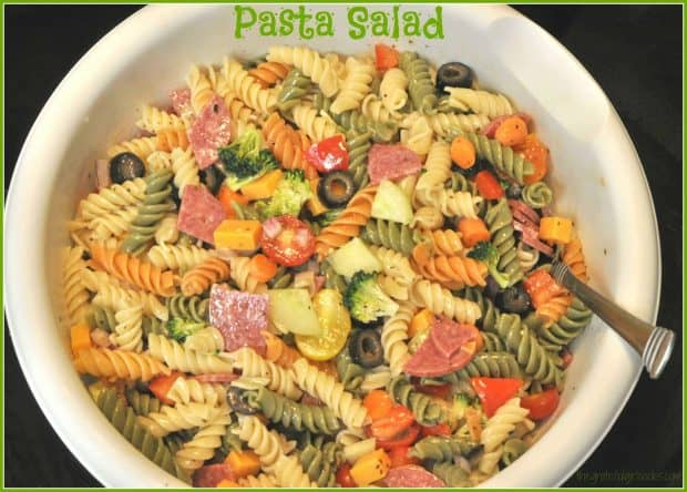 This quick (15 min.), and easy to make pasta salad with Italian dressing, salami, cheese, broccoli, olives and carrots will become a family favorite!