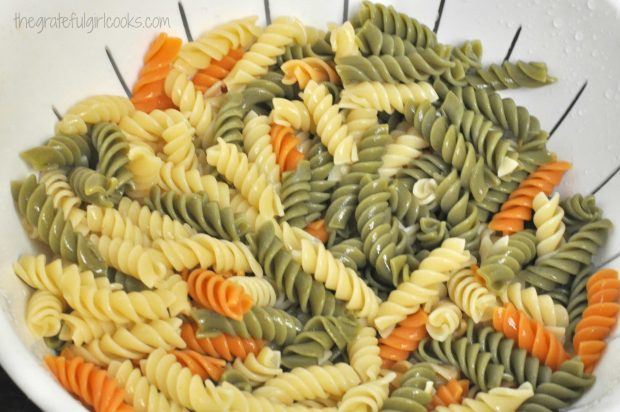 Colorful rainbow rotini pasta is used for the pasta salad.