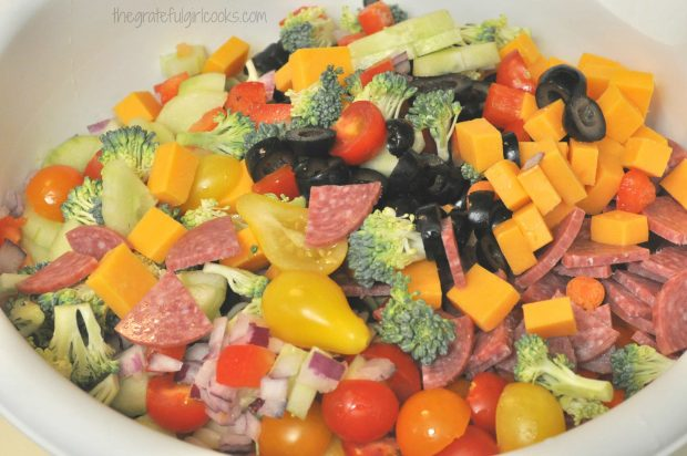 All the veggies and cooked pasta are placed in a large bowl.