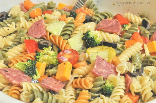 The pasta salad is dressed, and ready to serve!