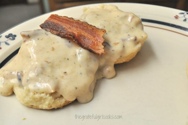 Southern Buttermilk Biscuits with bacon gravy on top, on plate