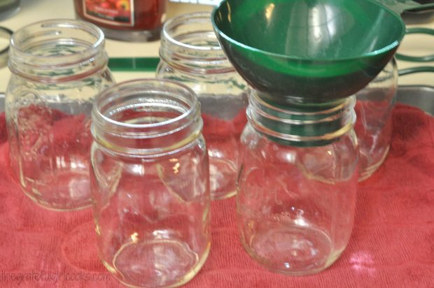 Preparing canning jars to process dried beans.