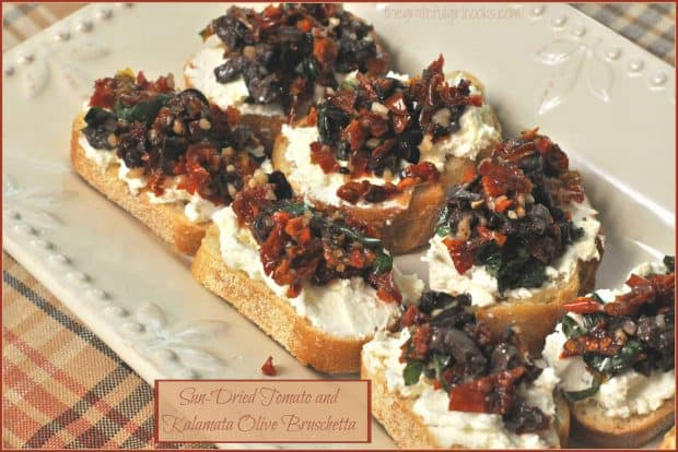 Sun-Dried Tomato And Kalamata Olive Bruschetta / The Grateful Girl Cooks! This delicious appetizer features garlic crostini with feta and cream cheeses, kalamata olives, sun-dried tomatoes and fresh basil!