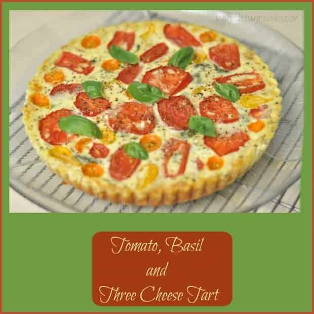Tomato Basil Three Cheese Tart has a flaky crust, tomatoes, Ricotta, Parmesan, Mozzarella cheese, Italian spices, and is perfect for breakfast, lunch OR dinner!